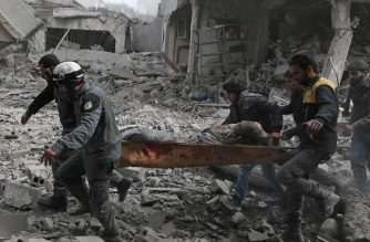 Members of the Syrian civil defense evacuate an injured civilian on a stretcher from an area hit by a reported regime air strike in the rebel-held town of Saqba, in the besieged Eastern Ghouta region on the outskirts of the capital Damascus, on February 20, 2018. / AFP PHOTO / ABDULMONAM EASSA