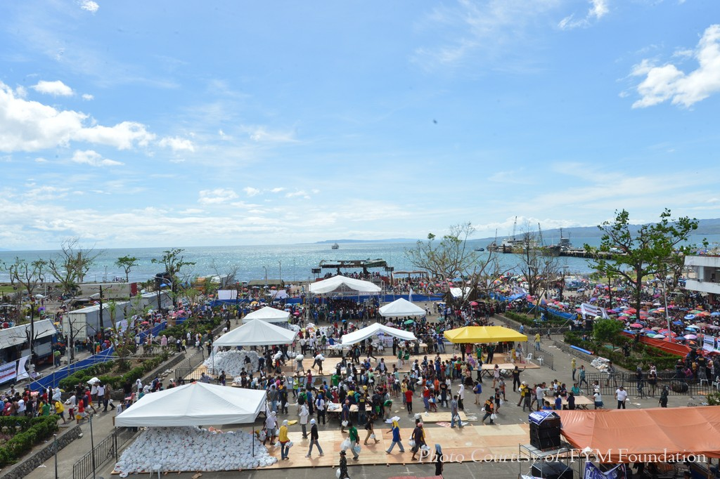 A view of the Ormoc City Plaza which was transformed into a massive relief distribution center with 15 relief distribution tables and a tent for the Iglesia Ni Cristo's Lingap sa Mamamayan for supertyphoon Yolanda survivors.  The people who lined up outside were given food packs upon entering the area.    Some 50,000 relief packs  were distributed to Ormoc residents  last Wednesday, Nov. 27 in the relief and medical mission of the INC done in cooperation with Felix Y. Manalo Foundation, Inc., the INC's charitable arm.