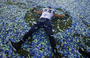 Seattle Seahawks Malcom Smith makes an angel in the confetti after his team defeated the Denver Bronocs in the NFL Super Bowl XLVIII football game in East Rutherford, New Jersey, February 2, 2014. Credit: REUTERS/Shannon Stapleton