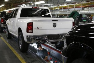 Chrysler Group assembly staff works below a 2014 Dodge Ram pickup truck at the Warren Assembly Plant in Warren, Michigan December 11, 2013. Credit: Reuters/Rebecca Cook