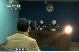 Chinese police interrogate a suspect involved in online baby trafficking. China has detained more than 1,000 people in a crackdown on online baby trafficking rings and rescued 382 infants, according to Chinese state media.  (Photo grabbed from Reuters/CCTV video)