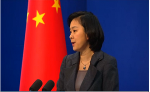 Chinese Foreign Ministry spokeswoman  Hua Chunying announcing Beijing's position that the Philippines is to blame for an incident in disputed waters in the South China Sea.  (Photo grabbed from Reuters video)