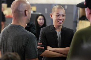 Designer Jason Wu laughs backstage while preparing to present his Spring/Summer 2014 collection during New York Fashion Week September 6, 2013. Credit: Reuters/Lucas Jackson