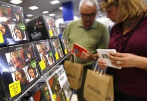 Customers browse Beatles collections during their launch in New York, September 9, 2009. Credit: Reuters/Shannon Stapleton