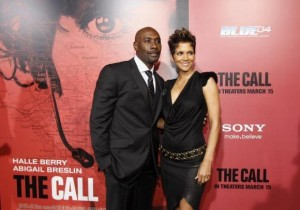 """File photo of actress Halle Berry seen here posing with co-star Morris Chestnut at the premiere of """"The Call"""" in Los Angeles, California March 5, 2013. REUTERS/Mario Anzuoni"""