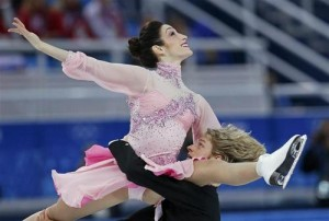 Meryl Davis (top) and Charlie White of the U.S. compete during the figure skating team ice dance short dance at the Sochi 2014 Winter Olympics, February 8, 2014. Courtesy REUTERS/Alexander Demianchuk
