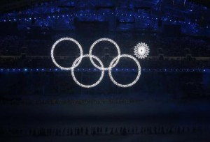 Four of the five Olympic Rings are seen lit up at the start of the opening ceremony of the 2014 Sochi Winter Olympics, February 7, 2014.  CREDIT: REUTERS/LUCY NICHOLSON