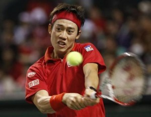 Japan's Kei Nishikori returns a shot against Canada's Frank Dancevic during their Davis Cup world group first round tennis match in Tokyo February 2, 2014. CREDIT: REUTERS/TORU HANAI