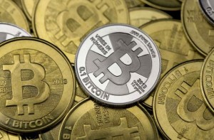 Some of Bitcoin enthusiast Mike Caldwell's coins are pictured at his office in this photo illustration in Sandy, Utah, January 31, 2014. CREDIT: REUTERS/JIM URQUHART