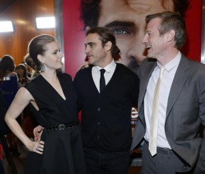 Cast members Amy Adams and Joaquin Phoenix stand next to writer/director Spike Jonze at the film premiere of ''Her'' at the Directors Guild of America in Hollywood December 12, 2013. CREDIT: REUTERS/KEVORK DJANSEZIAN
