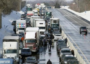 Drivers stand outside of their cars as traffic is backed up after a multi-car and truck accident during the morning commute, shutting down the major thoroughfare near the Bensalem interchange in Pennsylvania, February 14, 2014.  REUTERS/Tom Mihalek
