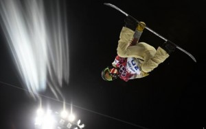 Shaun White of the U.S. performs a jump during a training session for the snowboard men's halfpipe competition at the 2014 Sochi Winter Olympic Games in Rosa Khutor February 10, 2014. Credit: Reuters/Dylan Martinez