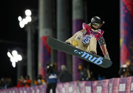 Kaitlyn Farrington of the U.S. performs a jump during the women's snowboard halfpipe finals at the 2014 Sochi Winter Olympic Games in Rosa Khutor February 12, 2014.  Credit: Reuters/Mike Blake