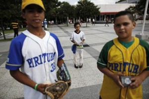 Children from Pirituba club, a Brazilian baseball club, are pictured during a summer baseball festival for children at the Sesc Belenzinho club in Sao Paulo January 19, 2014. Credit: Reuters/Nacho Doce