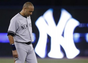 New York Yankees' Derek Jeter reacts after the end of the first inning against the Toronto Blue Jays during their MLB American League baseball game in Toronto in this file photo taken August 28, 2013. Credit: Reuters/Mark Blinch/Files