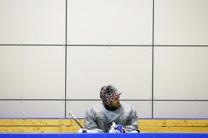 The U.S. men's hockey team goaltender Ryan Miller sits on the bench during a team USA practice at the 2014 Sochi Winter Olympics February 11, 2014. Credit: Reuters/Brian Snyder