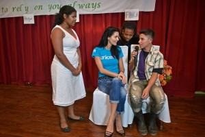 UNICEF Ambassador Angie Harmon participates with adolescents in a skit about the prevention of child abuse and exploitation in Bluefields, Nicaragua. courtesy: UNICEF/UN