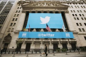 A sign displays the Twitter logo on the front of the New York Stock Exchange ahead of the company's IPO in New York, November 7, 2013. Credit: Reuters/Lucas Jackson