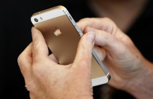 The gold colored version of the new iPhone 5S is seen after Apple Inc's media event in Cupertino, California September 10, 2013. Credit: Reuters/Stephen Lam