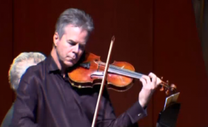 Milwaukee Symphony Orchestra concertmaster Frank Almond plays his famous Stradivarius violin in a concert.  Police recovered the violin which was taken from Almond by armed robbers in January.  Photo grabbed from Reuters video