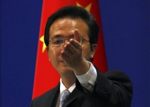 China's Foreign Ministry spokesman Hong Lei asks journalists for questions during a news conference in Beijing July 7, 2011. Credit: Reuters/David Gray