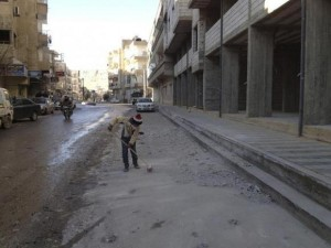 A boy cleans debris near buildings damaged by what activists said were shelling by forces loyal to President Bashar al-Assad, at Yabroud, near Damascus January 3, 2013. Credit: Reuters/Shaam News Network/Handout