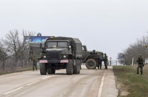 A military truck drives out of Belbek Airport in the Crimea region