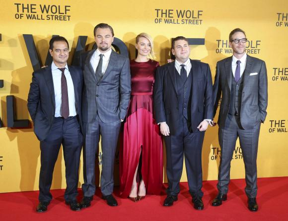Producer Riza Aziz (L-R), cast members Leonardo DiCaprio, Margot Robbie, Jonah Hill and producer Joey McFarland arrive for the U.K. Premiere of ''The Wolf of Wall Street'' at Leicester Square, in London January 9, 2014. Credit: Reuters/Paul Hackett