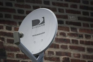 A Direct TV dish is seen outside a home in the Queens borough of New York July 29, 2013. Credit: Reuters/Shannon Stapleton