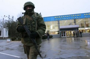 An armed man patrols at the airport in Simferopol, Crimea February 28, 2014. A group of armed men in military uniforms have seized the main regional airport in Simferopol, Crimea, Interfax news agency said early on Friday. REUTERS/David Mdzinarishvili
