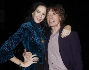 Musician Mick Jagger and designer L'Wren Scott pose following her Fall/Winter 2012 collection during New York Fashion Week