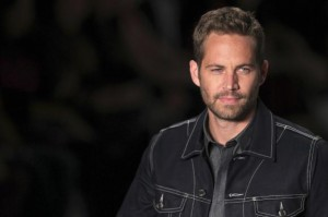 U.S. actor Paul Walker presents a creation from Colcci's 2013/2014 summer collection during Sao Paulo Fashion Week in this March 21, 2013 file photo. Credit: Reuters/Filipe Carvalho