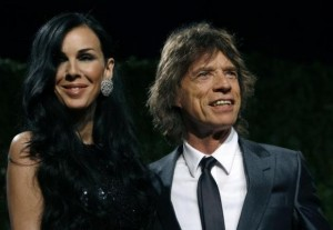 Designer L'Wren Scott and rock musician Mick Jagger pose as they arrive at the 2009 Vanity Fair Oscar Party in West Hollywood