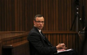 Olympic and Paralympic track star Oscar Pistorius sits in the dock during his trial for the murder of his girlfriend Reeva Steenkamp, at the North Gauteng High Court in Pretoria March 25, 2014. Credit: Reuters/Siphiwe Sibeko/POOL
