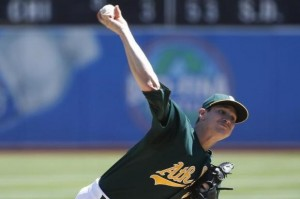 Oakland Athletics starting pitcher Parker delivers a pitch against the Texas Rangers during the first inning of their the MLB American League baseball game in Oakland, California