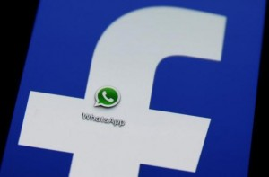 A Whatsapp icon is seen on a Samsung Galaxy S4 phone screen with a Facebook logo in the central Bosnian town of Zenica, February 20, 2014. Credit: Reuters/Dado Ruvic