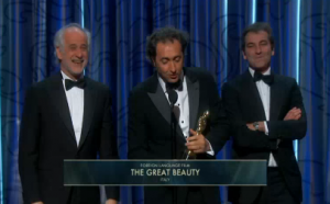 "Director Paolo Sorrentino accepts the award for the Italian drama ""The Great Beauty"" which won the Oscars for best foreign language  film. (Courtesy Reuters.  Photo grabbed from Reuters video)"