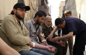 Men donate blood during a campaign to supply blood to field hospitals in Aleppo March 23, 2014. Credit: Reuters/Abdalrhman Ismail