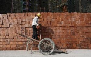 A labourer works at a construction site in Hangzhou, Zhejiang province, April 14, 2014. China's economy grew at its slowest pace in 18 months in the first quarter of 2014, official data showed on Wednesday, with signs of waning momentum already prompting limited government action to steady the world's second-largest economy. Picture taken April 14, 2014. REUTERS/William Hong