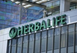 The Herbalife logo is seen on a building housing some of their offices in downtown Los Angeles, California April 28, 2013. CREDIT: REUTERS/LUCY NICHOLSON