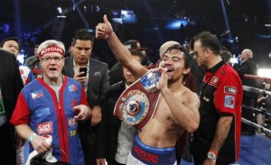 Manny Pacquiao of the Philippines celebrates his unanimous decision over WBO welterweight champion Timothy Bradley of the U.S. after their title fight at the MGM Grand Garden Arena in Las Vegas, Nevada April 12, 2014. Bradley was previously undefeated.  REUTERS/Steve Marcus