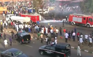 A blast at a bus depot on the outskirts of the Nigerian capital Abuja kills at least 35 people during rush hour on Monday morning. (Photo grabbed from Reuters video)