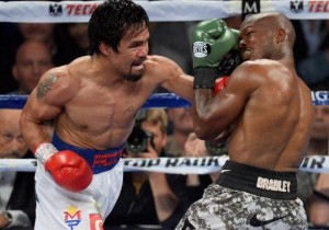 Apr 12, 2014; Las Vegas, NV, USA; Timothy Bradley (green gloves) and Manny Pacquiao (red gloves) box during their WBO World Welterweight Title bout at MGM Grand Garden Arena. Pacquiao won via unanimous decision. Mandatory Credit: Joe Camporeale-USA TODAY Sports