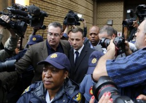 Oscar Pistorius leaves court after the second day of the trial of the Olympic and Paralympic track star at the North Gauteng High Court in Pretoria