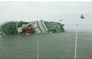 """The South Korean ferry """"Sewol"""" as it listed with more than 450 passengers on board. The radio conversation between South Korean controllers and the ferry crew sheds light on the situation as the vessel started to sink. (Courtesy Reuters)"""