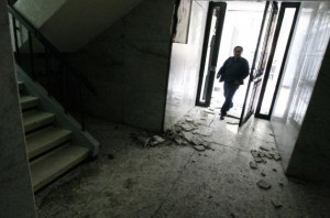 A man enters an apartment building with cracked walls and rubble on the floor following an earthquake in Mexico City April 18, 2014. Credit: Reuters/Bernardo Montoya