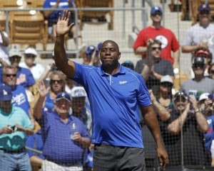 Los Angeles Dodgers co-owner Earvin Magic Johnson acknowledges the crowd before MLB Cactus League spring training baseball game against the Cincinnati Reds in Glendale