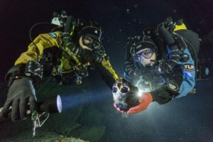 Handout of divers Nava and Bird transporting a skull to an underwater turntable for photographing in an underwater cave in Mexico's Yucatan Peninsula