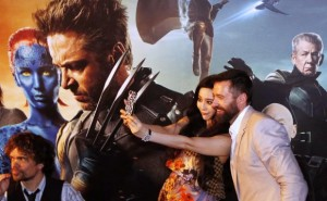 Cast members Hugh Jackman and Fan Bingbing take photos as Peter Dinklage waves to fans at the South East Asia premiere of X-Men: Days Of Future Past in Singapore