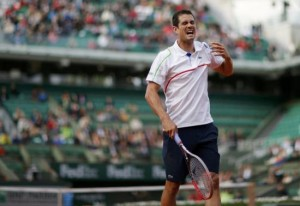 Guillermo Garcia-Lopez of Spain reacts during his men's singles match against Stanislas Wawrinka of Switzerland at the French Open tennis tournament at the Roland Garros stadium in Paris